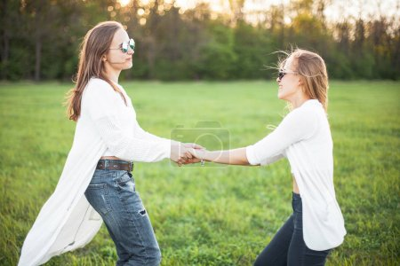 Young girls on field in sunlight