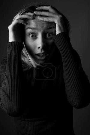 Photo for Frightened woman with hands near her face. Black and white - Royalty Free Image