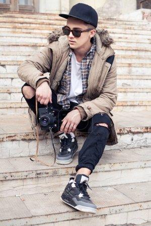 Stylish guy with camera