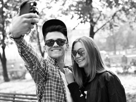Young man and woman making selfie