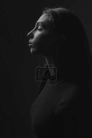 black and white portrait in profile of young woman