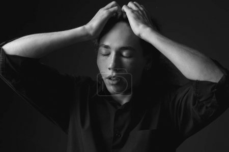 Monochrome portrait of young man with closed eyes