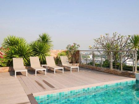 BANGKOK, THAILAND - DECEMBER 21, 2016: An infinity poolside on top of a hotel looking over Bangkok suburban area