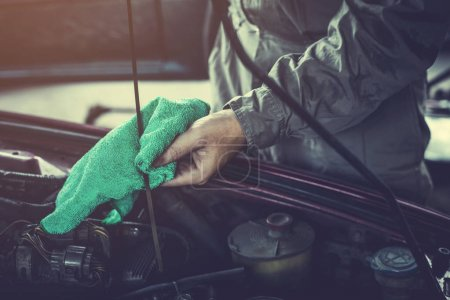 Photo for Technician working on checking and service car in  workshop garage; technician repair and maintenance engine of automobile in car servic - Royalty Free Image