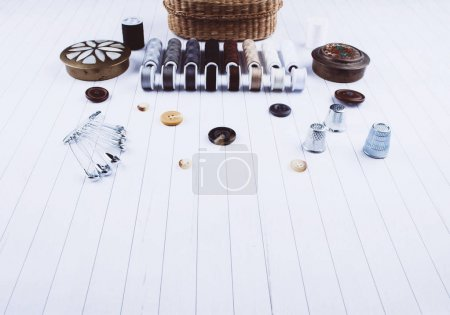 Background with sewing tools and accessories.