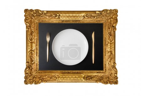 Photo for Empty dish in frame hanging on white - Royalty Free Image