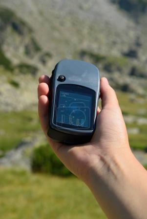 Man holding a gps device to...