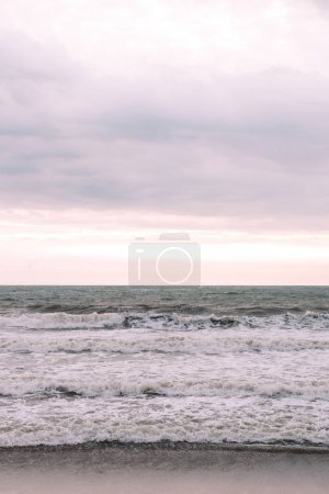 ocean waves and cloudy sky