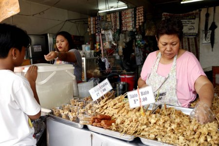 Assorted fried pork and chicken innards are sold at snack store at the back of the Antipolo Cathedral