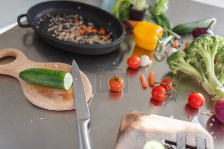 Photo for The process of cooking vegetables in a kitchen room. Close-up of different ingredients for a healthy dish. - Royalty Free Image