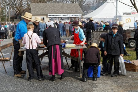 Amish Volunteers Packaging Barbecued Chicken