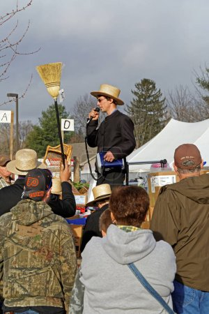 Amish Auctioneer Sells Items at Annual Mud Sale
