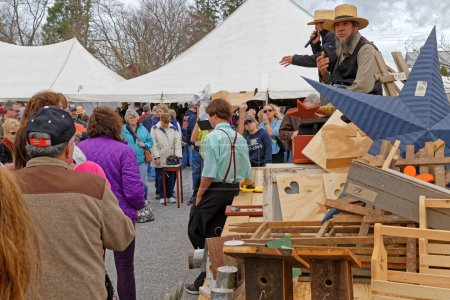 Amish Auctioneers Sell Items at Annual Mud Sale