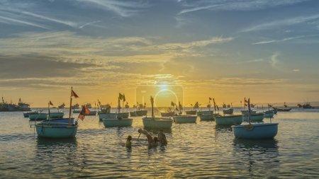 Sunset at Fishing village and traditional Vietnamese fishing boats