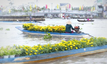 Boats flower exchange trade on the river in the morning