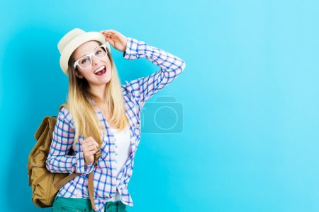 Photo for Happy young traveling woman on blue background - Royalty Free Image
