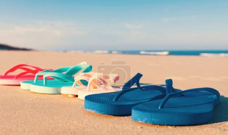 Colorful sandals at the beach