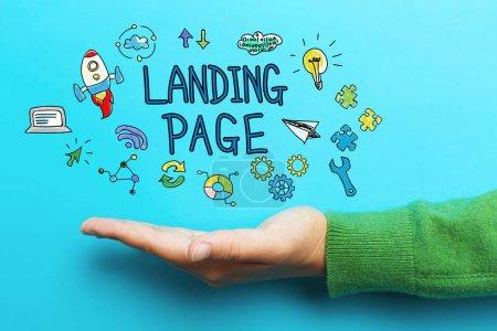 Photo pour Concept de Page d'atterrissage avec main sur backgroun bleu - image libre de droit