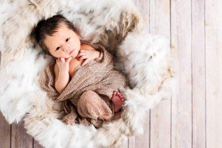 Newborn baby boy in a basket