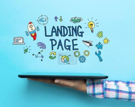 Photo pour Concept de Page d'atterrissage avec une tablette sur fond bleu - image libre de droit