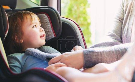 Toddler girl in car