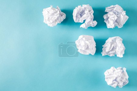 Photo for Crumpled paper balls on blue background - Royalty Free Image