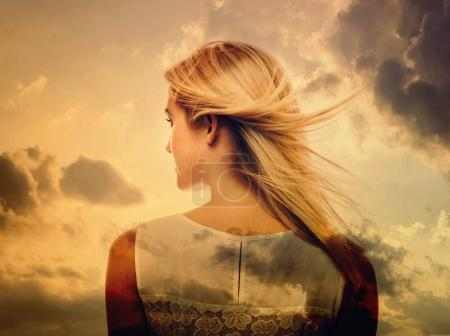 beautiful young woman and sky