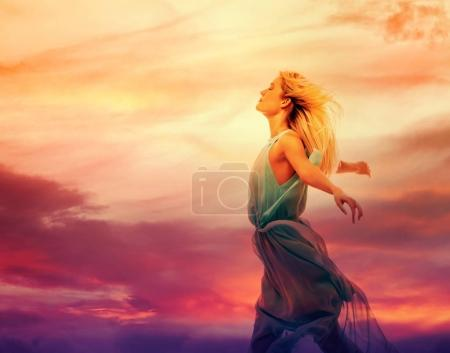 woman standing with arms wide open