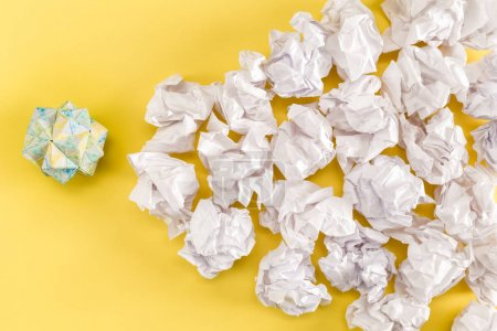 Crumpled paper balls on a yellow background...