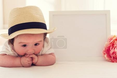 Happy baby boy with photo frame