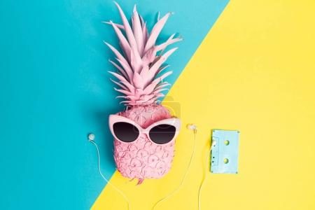 Photo for Painted pineapple with sunglasses on a vibrant duotone background - Royalty Free Image
