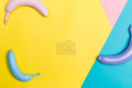 Photo for Colorful Painted bananas on a vibrant tritone background - Royalty Free Image