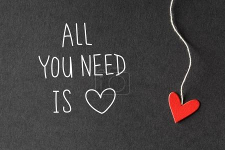 All You Need Is Love message with paper hearts