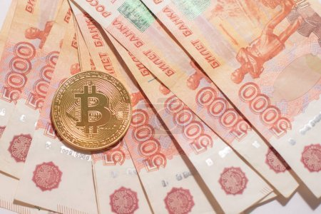 Photo for Bitcoin coin on Russian rubles background - Royalty Free Image