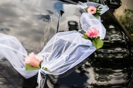 Flowers and decoration on wedding car