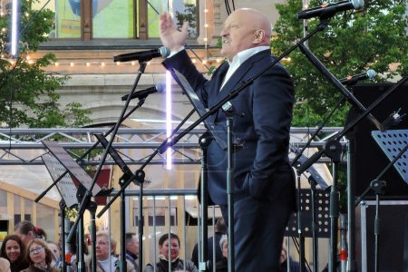 Book Fair on Red Square in Moscow. Actor Evgeny Chindyaikin performs on stage