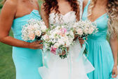 Bride with two bridesmaids in mint dresses