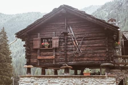 a nice old wood house in mountain. Italy