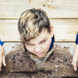 Young caucasian boy in medieval pillory. Negative ...