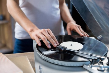 woman using vinyl audio player