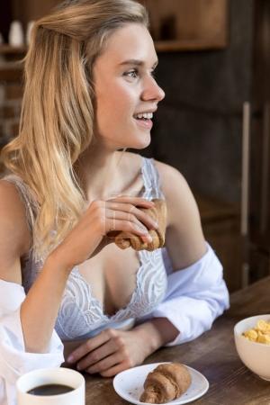 woman having breakfast in kitchen