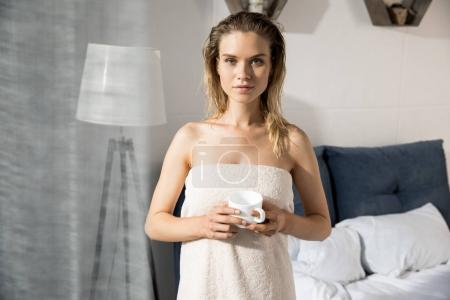 Young woman in bedroom