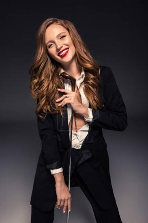 seductive smiling woman standing with golf club