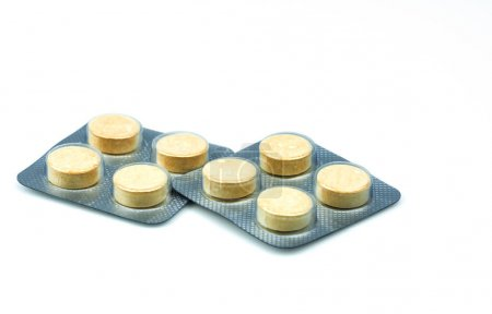 Anthelmintic tablets pills in blister packs on white background with copy space. Set of four tablets pills : niclosamide and phenolphthalein for treatment tapeworm. Chewable tablet pills.