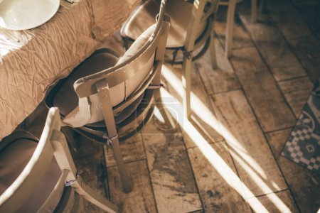 Wooden chairs on the sunset at restaurant