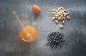 honey, egg, cashew nuts and blackberries