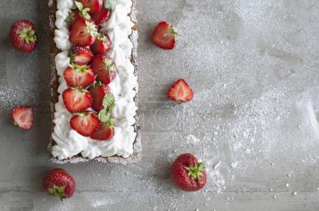 Photo for Delicious Strawberry Tart with Meringue or Whipped Cream - Royalty Free Image