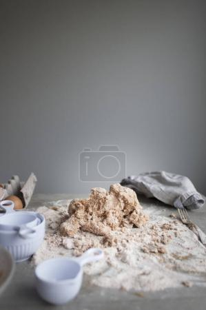 Photo for Dough and flour with ingredients for making bread on table - Royalty Free Image