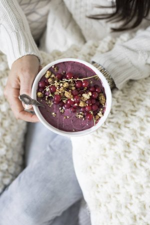 woman holding Acai Bowl with Berries