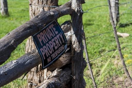 No trespassing sing on wooden fence